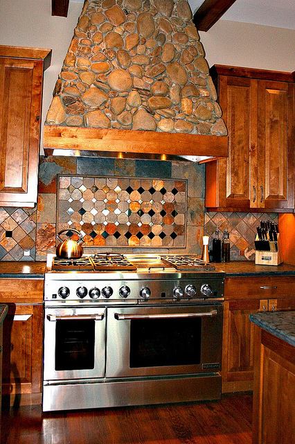 A combination of slate, metal and granite to create an amazing kitchen backsplash. Photo ©: Malia Lonneville: via Flickr under Creative Commons Licence