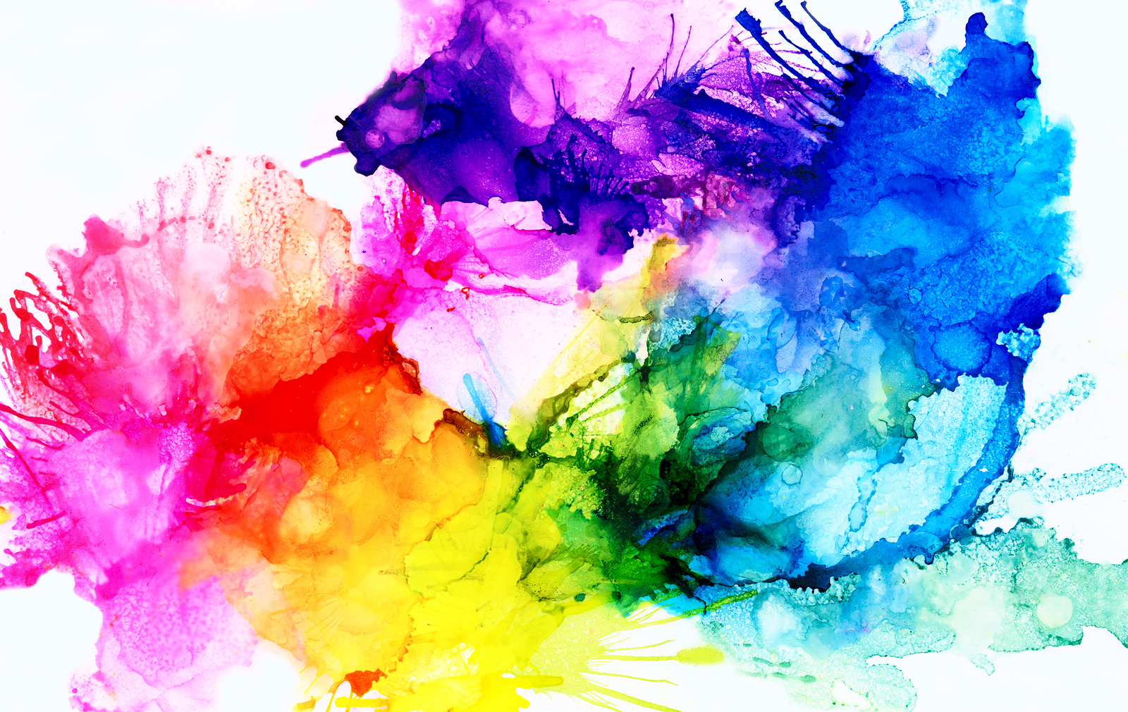 Abstract backdrop.Colorful painted background hand drawn with bright inks and watercolor paints. Bright color splashes and splatters create uneven artistic background.