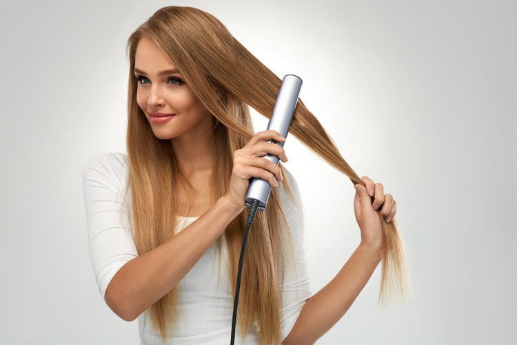 straightening your hair with a hair straightener