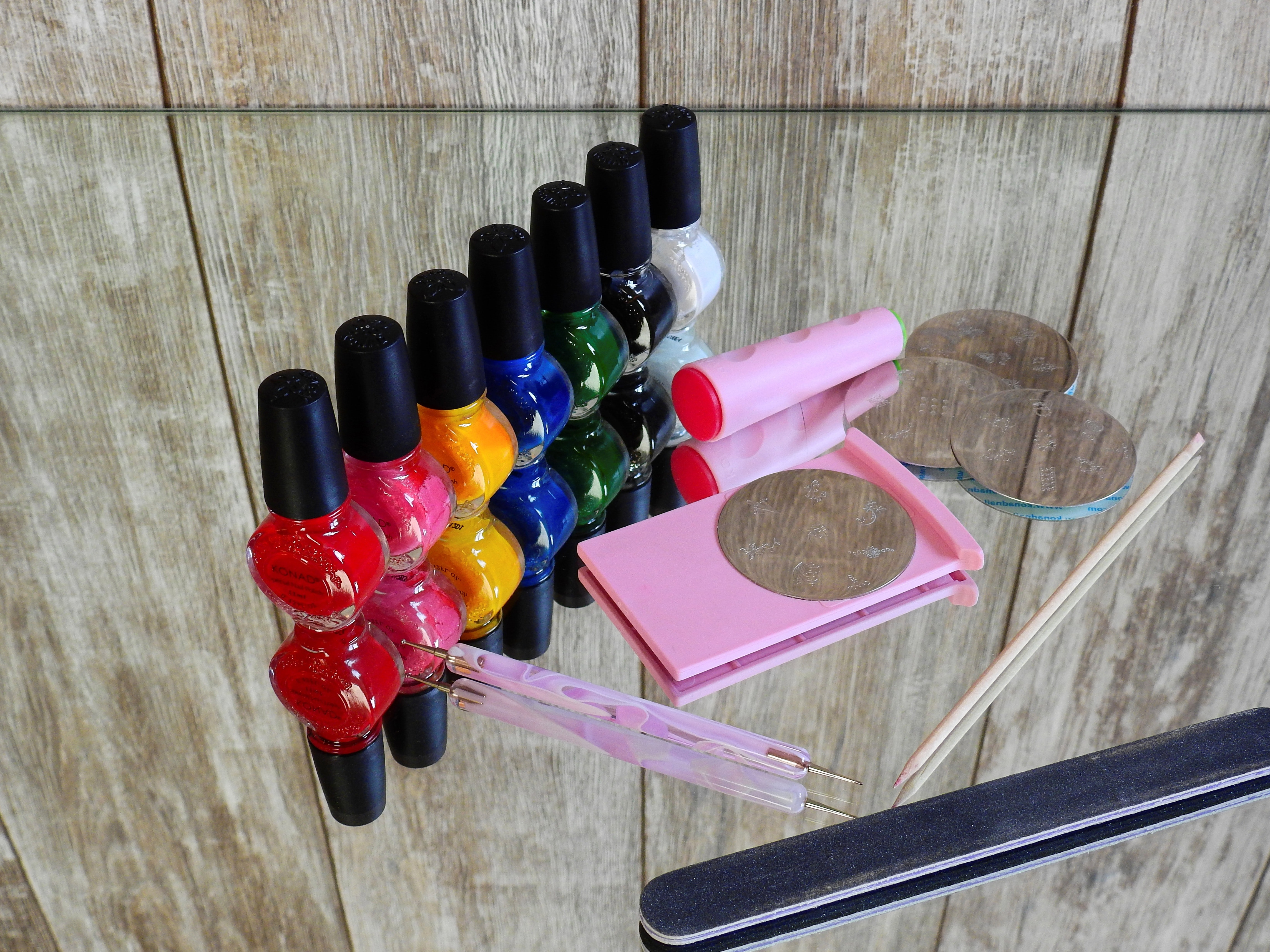 different colored Nail polishes with other equipment needed for nail designs